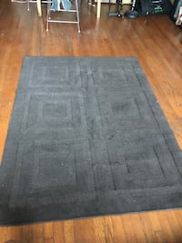 4' x 5.5' brown area rug