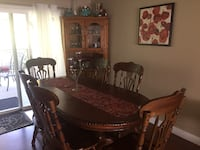 Brown wooden dining table with chairs Chilliwack, V2P 6M9