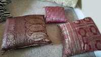 three red and gray throw pillows
