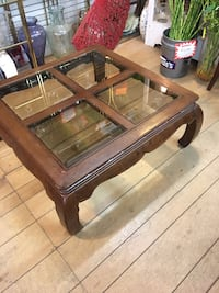 brown wooden framed glass top coffee table Hampton, 23661