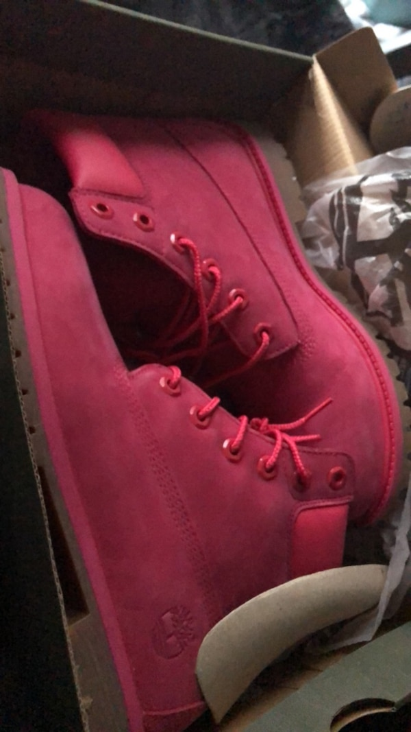 pair of red Timberland work boots in box