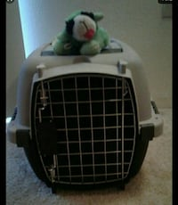 black and  and gray pet carrier