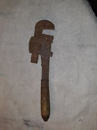 Adjustable pipe wrench.