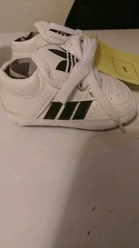pair of white Adidas Superstar Wilkes-Barre, 18702