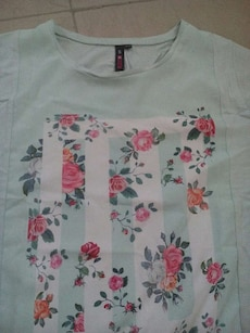 teal, white and pink floral crew neck shirt