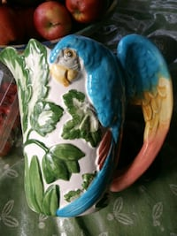white, blue, and green ceramic pitcher Vancouver, V5X 1N4