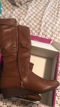 Pair of brown leather knee high boots