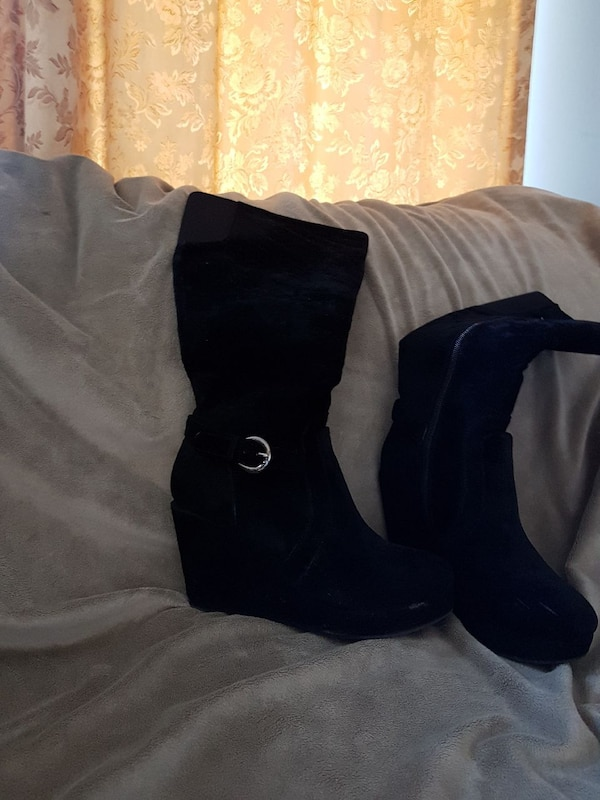 pair of black suede wedge wide-calf boots