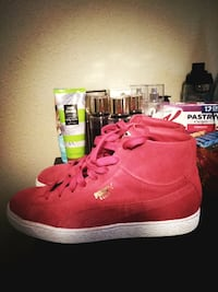 pair of red puma high-top sneakers Gulfport