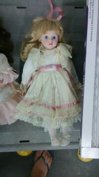 girl in white and pink Victorian dress porcelain doll