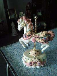white and pink ceramic figurine horse