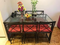 black metal framed glass top table with chairs Mississauga, L5B 2H4