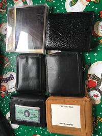 six black and brown leather bifold wallets