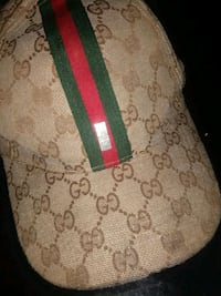 brown and red Gucci monogram cap Washington, 20011