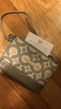 Real coach clutch/wristlet, never used