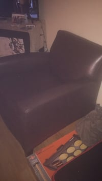 Black leather padded rolling armchair Denver, 80222
