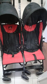 baby's red and black twin stroller