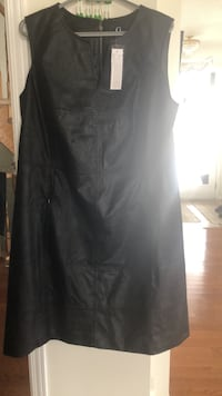 Leather dress brand new black size18w..not real leather..two zipper pockets on front..long zipper opening in back..brand by giuliana 733 km
