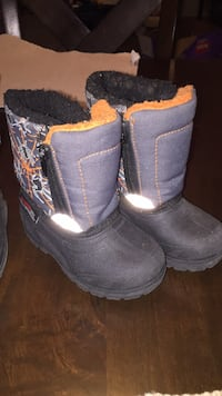 Size 6 Pair of black-and-orange boots Winnipeg, R2J 3N5