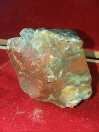 green and brown stone fragment Price, 84501