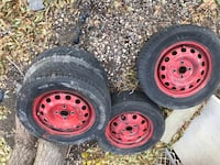 four black bullet-hole vehicle wheel and tire set Regina, S4T