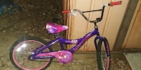 purple and white BMX bike