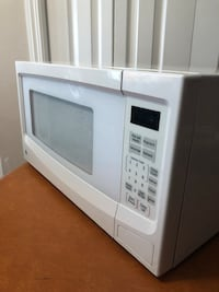 White general electric microwave oven Calgary, T3J 3C2