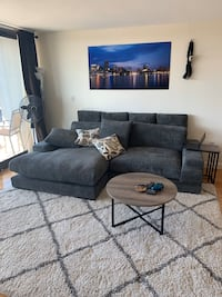 Sectional, with area rug coffee table and side table