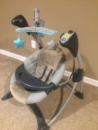Grey and black cradle and swing