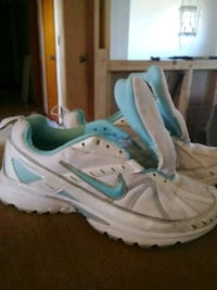 pair of white-and-teal Nike running shoes