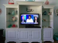 flat screen television with white wooden TV hutch Daytona Beach