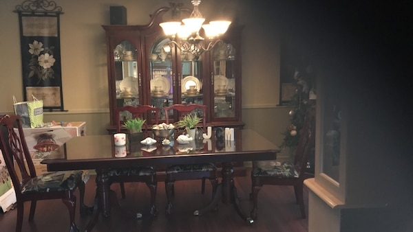 Cherry wood beautiful dining room set with six chairs and China cabinet