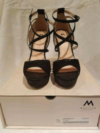pair of black open-toe ankle strap heels 550 km