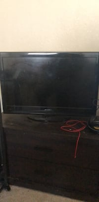 black flat screen TV with remote Fort Belvoir, 22309