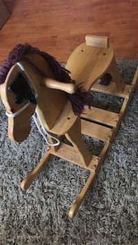 Toddler's brown wooden ride on horse