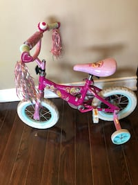 toddler's pink and white bicycle with training wheels Toronto, M9V