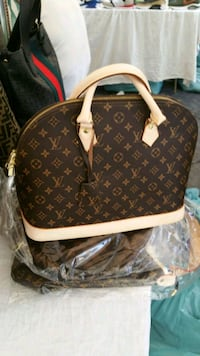 borsa in pelle marrone Louis Vuitton 7424 km
