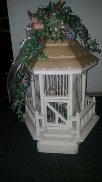 white and brown wooden birdcage