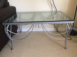 Silver Glass top coffee table negotiable      Just pick it up