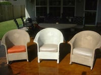 three assorted-color wicker padded chairs