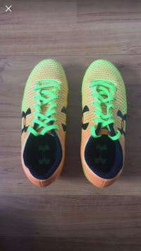 Pair of green-and-blue nike running shoes 23 km