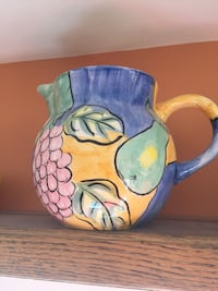 yellow-and-multicolored fruits paint ceramic vase