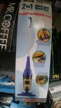 blue and black Bissell upright vacuum cleaner box Toronto, M3L 1T7