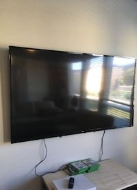 black flat screen TV with remote VANCOUVER