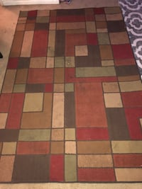brown, red, and black area rug Hinesville, 31313