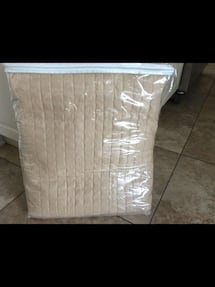 BRAND NEW QUEEN SIZE QUILTED COVERLET.