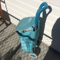 baby's blue and black stroller Maple Ridge