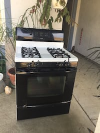Four burner gas stove looks and works like new. On the carport must be picked up. Benicia, 94510
