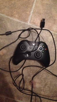 Black Xbox One game controller and charging cable Edmonton, T6P 1E5