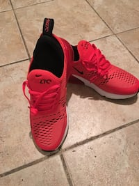 Pair of red nike running shoes Toledo, 43620